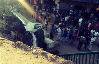 مصرع وإصابة 8 أشخاص في حادث سقوط سيارة من أعلى الدائري   صور