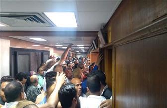 اشتباكات بالأيدي بين أنصار مرشحي غرفة القاهرة التجارية وأفراد الأمن | صور
