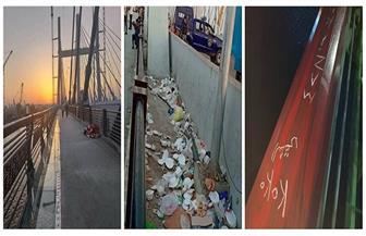 بعد شهر من افتتاحه.. تعد صارخ على كوبري محور روض الفرج بإلقاء القمامة | صور