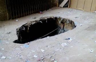 بسبب بئر صرف قديم.. إصلاح هبوط أرضي بحي العجمي بالإسكندرية |صور