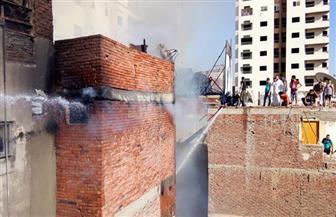 حريق بعقار في شارع الدراسات بالمنصورة  صور