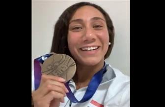 اللجنة الأوليمبية تهنئ فريدة عثمان واتحاد السباحة ببرونزية بطولة العالم