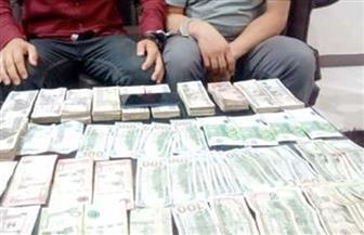 ضبط شخصين لقيامهما بالاتجار غير المشروع في النقد الأجنبي بالإسكندرية
