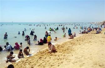 استمرار التوافد على شواطئ السخنة في رابع أيام عيد الأضحى| صور