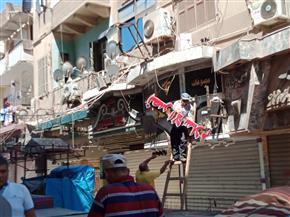 استمرار رفع آثار حريق شارع مصر بالإسماعيلية استعدادا لإعادة افتتاحه