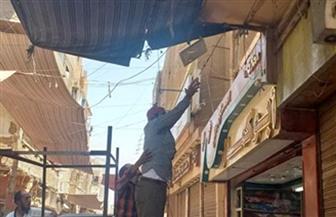 محافظ أسيوط: حملة مرافق بشارع بورسعيد لرفع الإشغالات ومخالفات المحال التجارية | صور