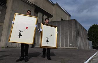لوحات بانسكي في أكبرمزاد بلندن.. والفنان الغامض يرفض مغريات الشهرة| صور