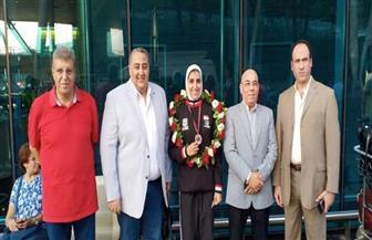 استقبال حافل لجيانا فاروق بعد فوزها بذهبية الدوري العالمي للكاراتيه | صور