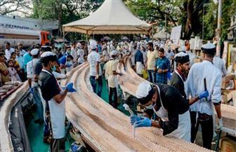 أطول كعكة فانيلا في العالم بالهند| صور