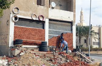 جهاز مدينة القاهرة الجديدة يسترد 3 وحدات مخالفة بالتجمع الخامس | صور