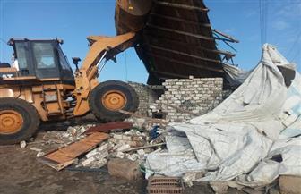 إزالة مبنى مقام على أملاك دولة في بورسعيد.. وتركيب 10 أغطية لبالوعات تصريف مياه الأمطار| صور