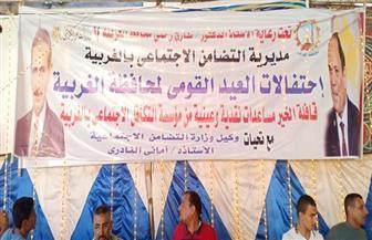 مساعدات عينية لـ100 أسرة في قرية الكمالية بالغربية احتفالا بالعيد القومي | صور