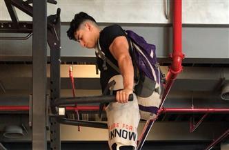 مصري يحصد لقب جينيس للأرقام القياسية برفع أثقل وزن لتمرين الضغط المتوازي بالذراعين | صور