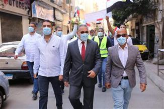 مرشحا القائمة الوطنية يقودان مسيرة شبابية بالإسكندرية لحث المواطنين على المشاركة بالانتخابات | صور