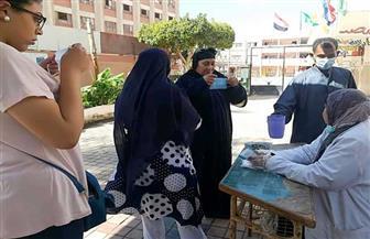 سيدات الفيوم يدلين بأصواتهن في انتخابات النواب بالكمامات | صور