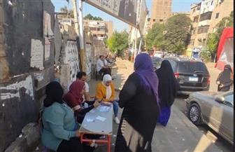 السيدات والفتيات يتصدرن المشهد في ثانى أيام انتخابات النواب بالعجوزة | صور
