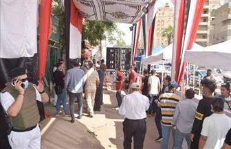 طوابير الجيزة مستمرة.. وحشد كبير أمام اللجان الانتخابية| صور