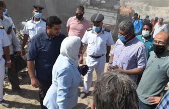 جهاز 15 مايو ينفذ حملة لإزالة المباني المقامة على مخرات السيول بمنطقة الزرايب   صور