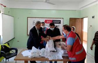 """""""الهلال الأحمر"""" يوزع معونات غذائية لـ 300 أسرة من المطلقات والأرامل في بورسعيد   صور"""