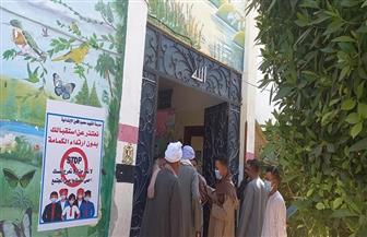 التزام بالكمامة الطبية في اللجان الانتخابية والدفع بفرق الهلال الأحمر بقنا   صور