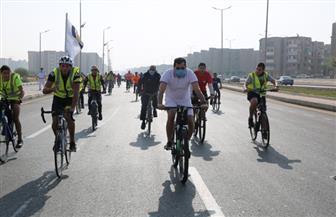 وزير الرياضة يوجه رسالة لجماهير الأهلي والزمالك عبر ماراثون دراجات الشروق| صور