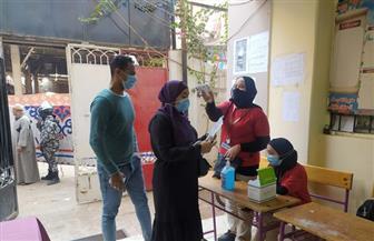 إجراءات احترازية مشددة أمام لجان بالقاهرة | صور