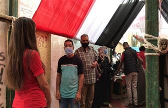 إقبال كبير على التصويت بلجان الاقتراع في مصر القديمة | صور