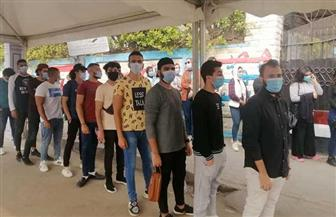 الشباب في طليعة المصوتين وطوابير أمام لجنة الطبري في روكسي بمصر الجديدة| صور