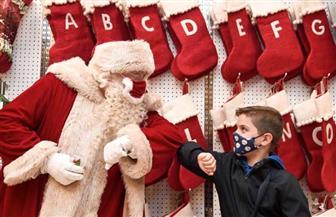 بابا نويل بـ «الكمامة» | صور
