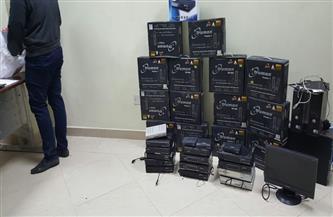 """ضبط 120 """"ريسيفر"""" لفك شفرة القنوات الفضائية بحوزة تاجر بالقاهرة"""