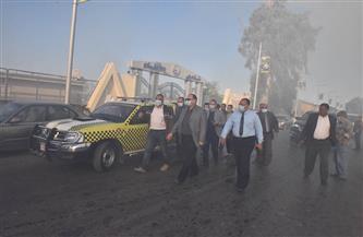محافظ أسيوط يتفقد أعمال السيطرة على حريق ببعض الأشجار والمخلفات على ترعة الإبراهيمية | صور