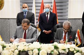 وزير القوى العاملة ورئيس جامعة بورسعيد يوقعان بروتوكولي تعاون | صور