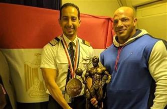 «بيج رامي» بطل «مستر أولمبيا» يصل مطار القاهرة