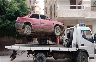 رفع السيارات المهملة من شوارع الإسكندرية وإيداعها بأم زغيو| صور