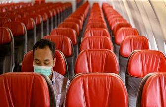 """بالكمامة فقط.. """"وحيدا"""" في الطائرة إلى """"بؤرة الوباء"""""""