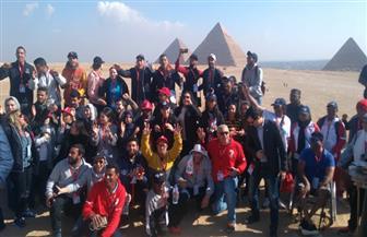 وفد دورة الألعاب الإقليمية الإفريقية للأولمبياد يزور منطقة أهرامات الجيزة | صور