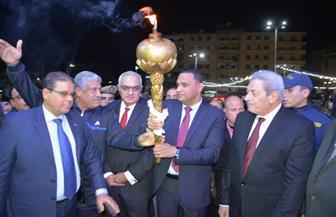 محافظ الدقهلية يوقد الشعلة إيذانا ببدء الاحتفالات بالعيد القومي| صور