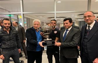 وزير الرياضة يستقبل فريق الزمالك بمطار القاهرة بعد التتويج بالسوبر الإفريقي|صور