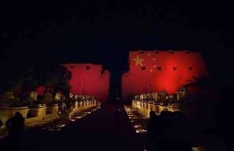 إضاءة معابد الكرنك وفيلة بألوان العلم الصيني تضامنا مع بكين في أزمة كورونا| صور