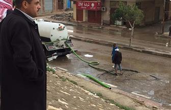 شفط كميات كبيرة من مياه الأمطار ببئر العبد |صور