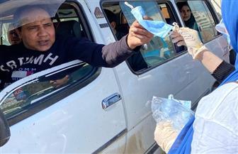 توزيع كمامات وقفازات طبية على المواطنين والمارة في الغربية | صور