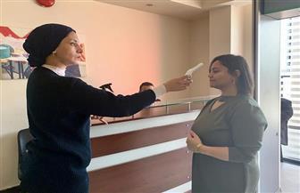 للوقاية من «كورونا».. «القومي للمرأة» يلغي البصمة الإلكترونية ويوفر أجهزة قياس درجة الحرارة | صور