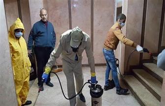 تطهير وتعقيم مسكن أول حالة كورونا في بورسعيد | صور