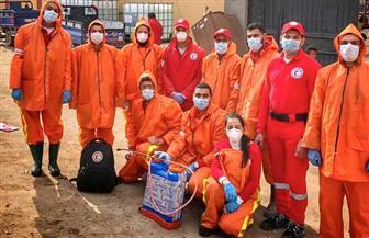 الهلال الأحمر يعقم المناطق التي يتم العمل بها لتقديم الإغاثة والمساعدات | صور