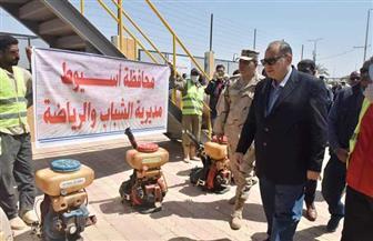 محافظ أسيوط يشهد انطلاق حملة مكبرة لتعقيم وتطهير المراكز والأحياء والمرافق | صور