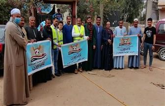 """شباب حزب """"المصريين"""" يقود حملة لتعقيم منازل وشوارع سوهاج   صور"""