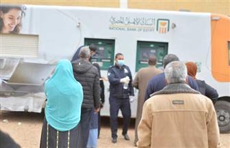 أول مرة.. البنك الأهلي المصري يدفع بماكينات صرف آلي متحركة للحد من انتشار فيروس كورونا | صور