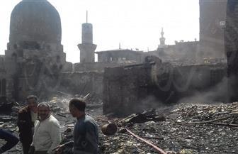 آثار الحريق الذى شهدته منطقة الدرب الأحمر الجمعة الماضية | صور