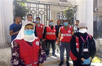 صرف المعاشات في قنا بمساعدة الشرطة والهلال الأحمر | صور