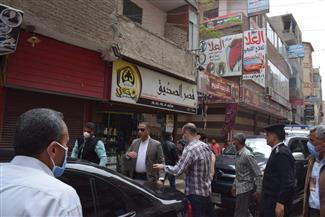 حملة مكبرة لرفع الإشغالات بأكثر الشوارع زحاما بالفيوم | صور